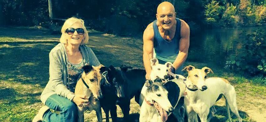 Vince and wife Sue enjoy some time in the park with their greyhounds.
